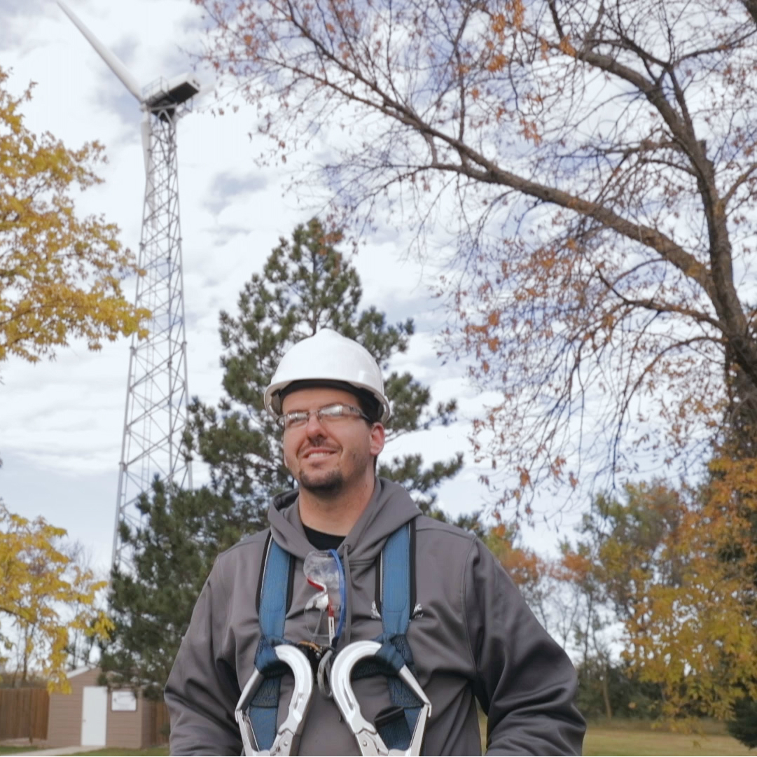 Colby Azevedo prepares to climb the wind tower he is learning to service at Minnesota West Community and Technical Colleg